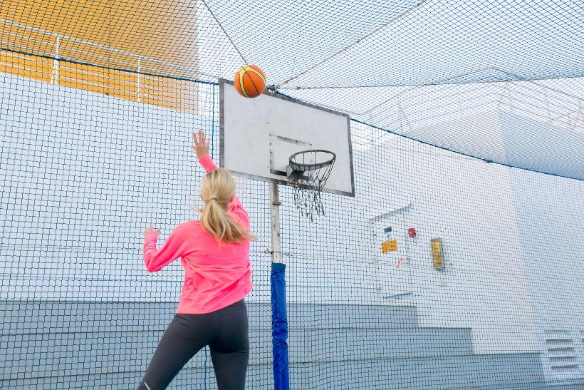 woman playing basketball onboard cruise ship