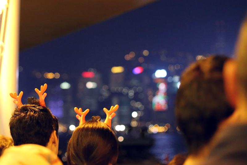 people wearing christmas antlers