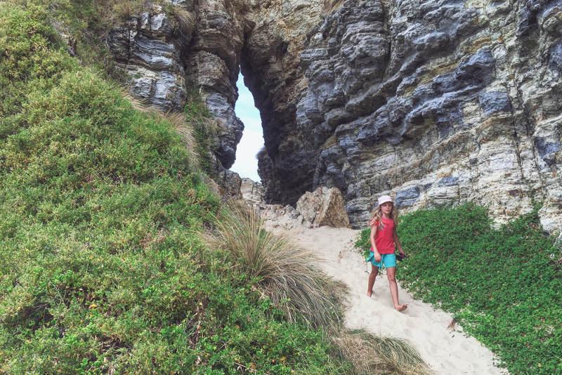 A child walks down a sandy path on Bruny Island, Tasmania.
