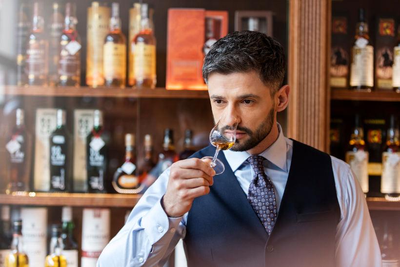 man smelling whisky