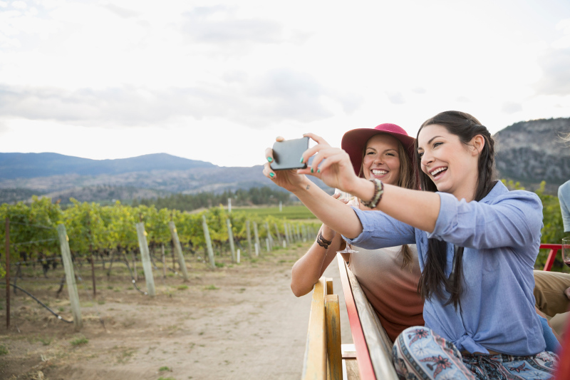 Two women take a selfie in a winery