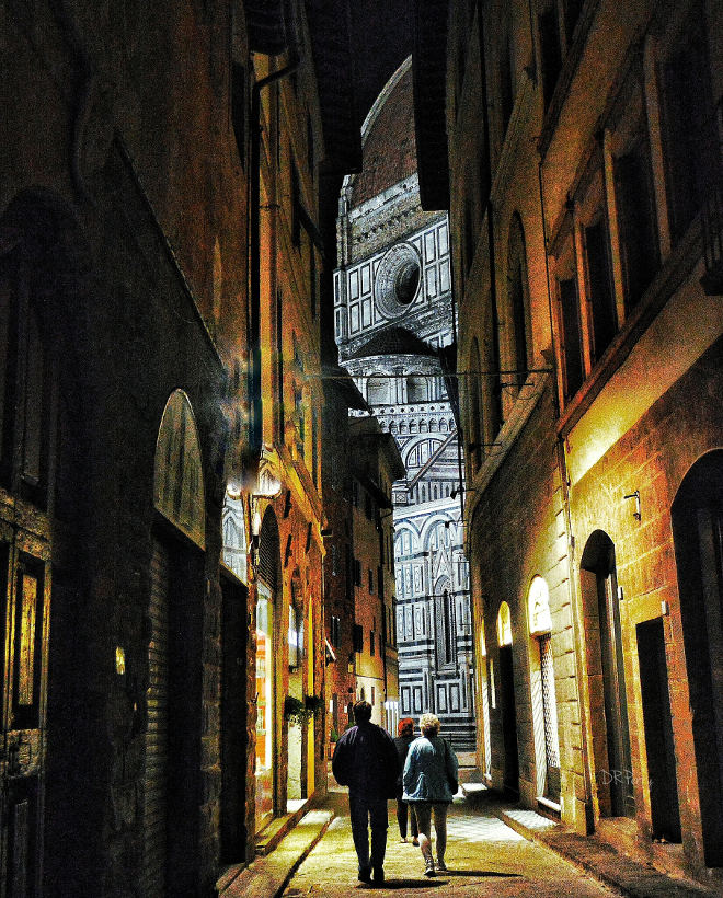 nighttime stroll toward the duomo in florence