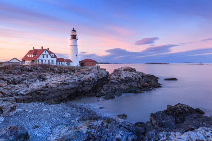 New england lighthouse and coastline at dusk