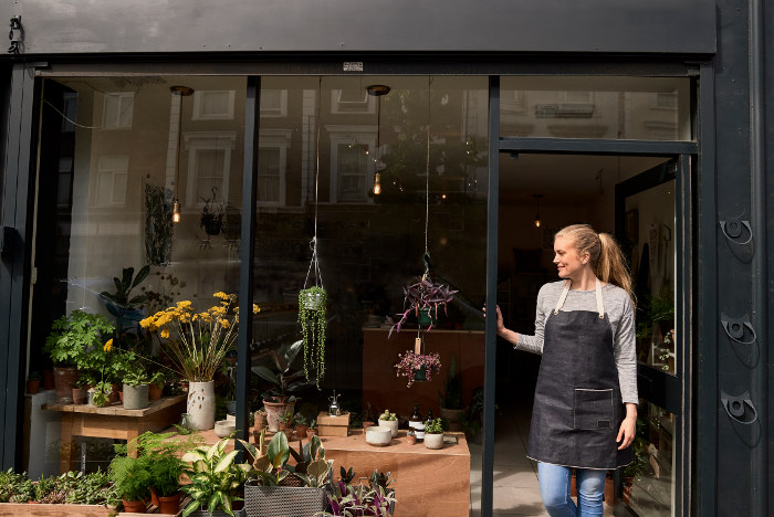 woman in doorway of plant shop london