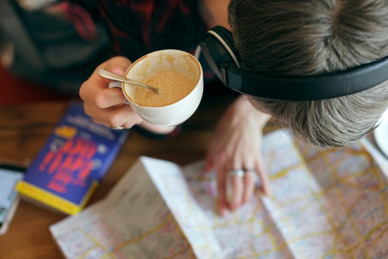 Woman looking at travel map