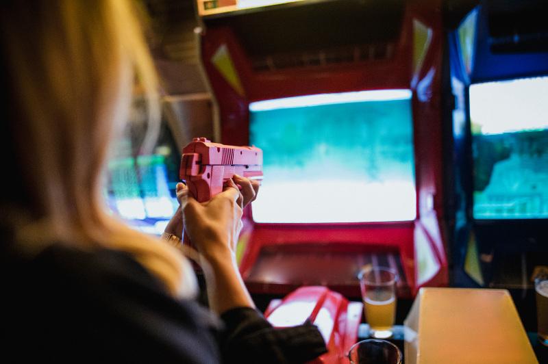 Woman playing arcade game