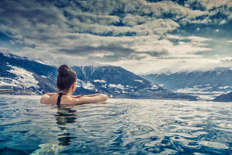 woman in pool overlooking mountains