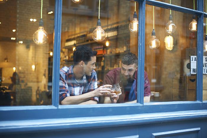 mates sitting in pub in london