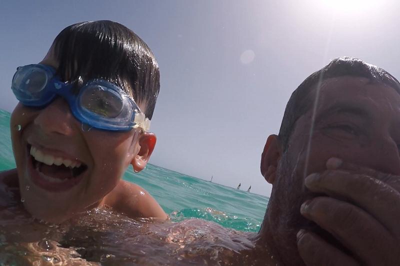Father and son having fun in pool