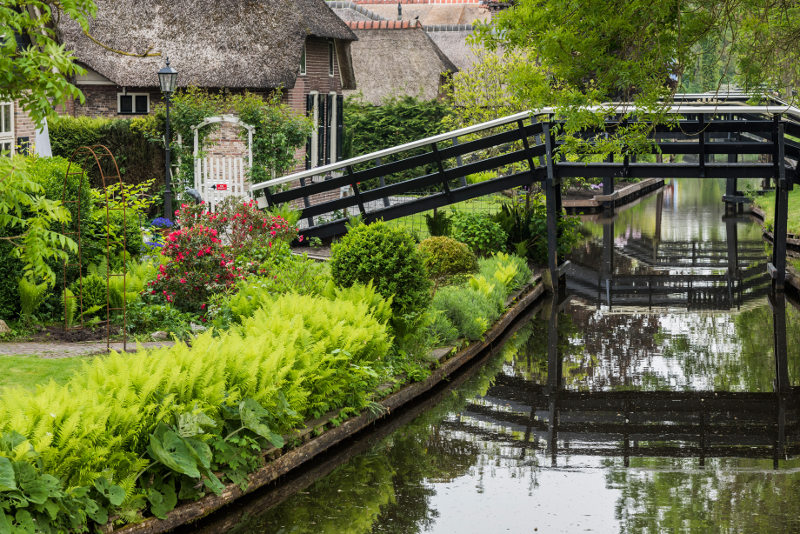 Wooden bridge over canal in Giethoorn, the Netherlands. Image: Getty