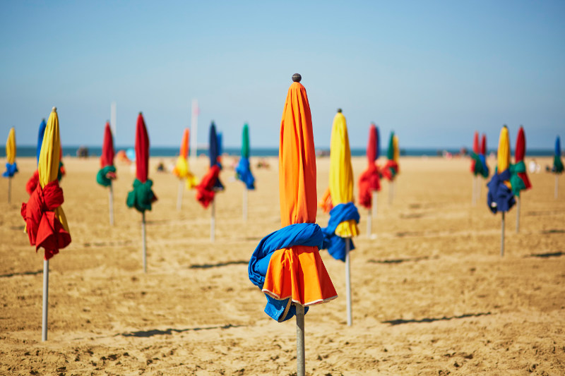 Parasols on the beach at Deauville, France