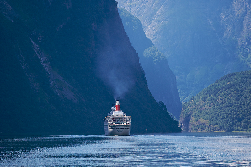 mid size ship in fjord in norway