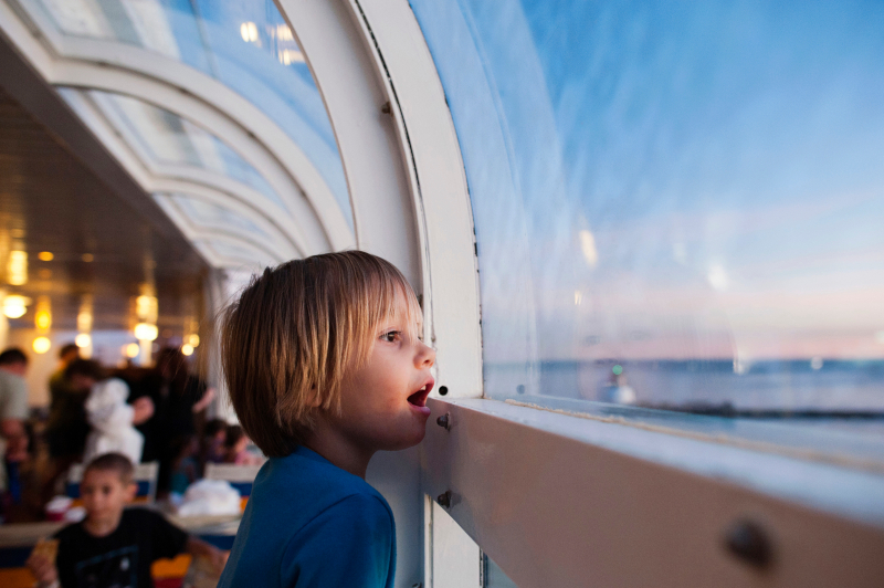 a child looking out the cruise window