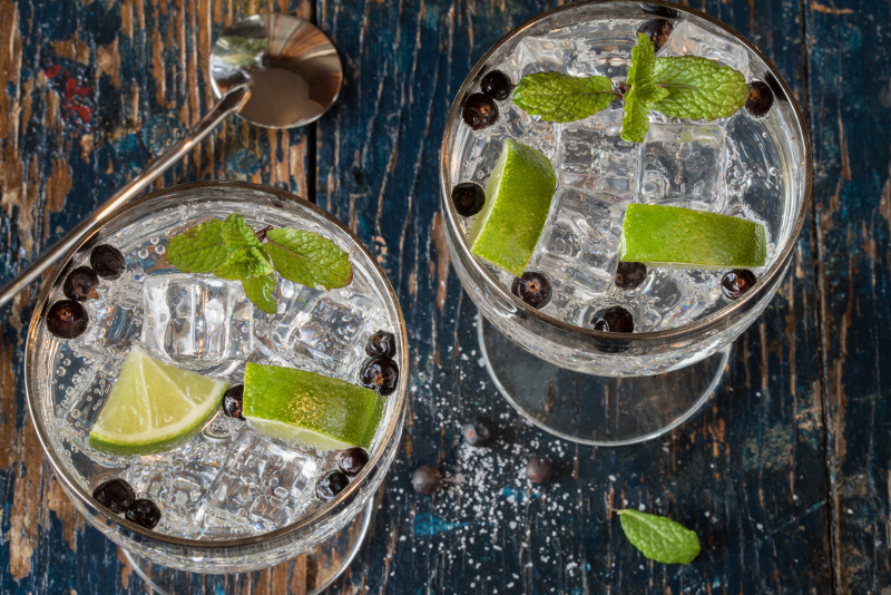 Zesty gin & tonic paired with fresh lime, mint and juniper berries