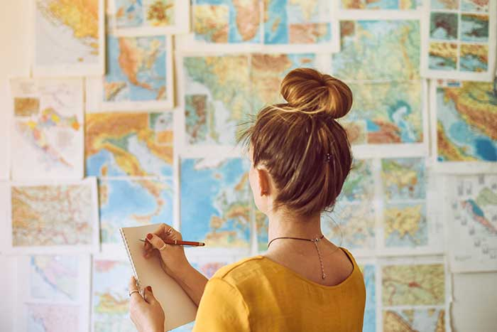 girl studying world map