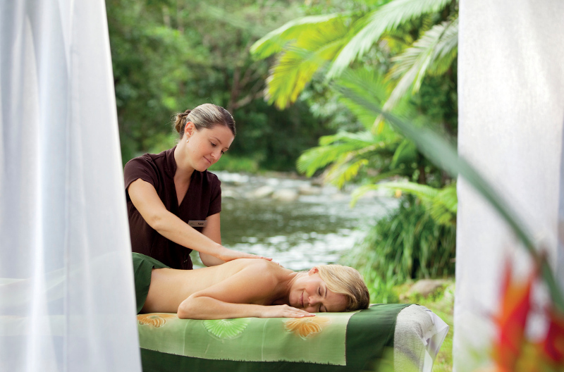 A woman receives a massage at Silky Oaks Lodge & Healing Waters Spa in Mossman, Tropical North Queensland.