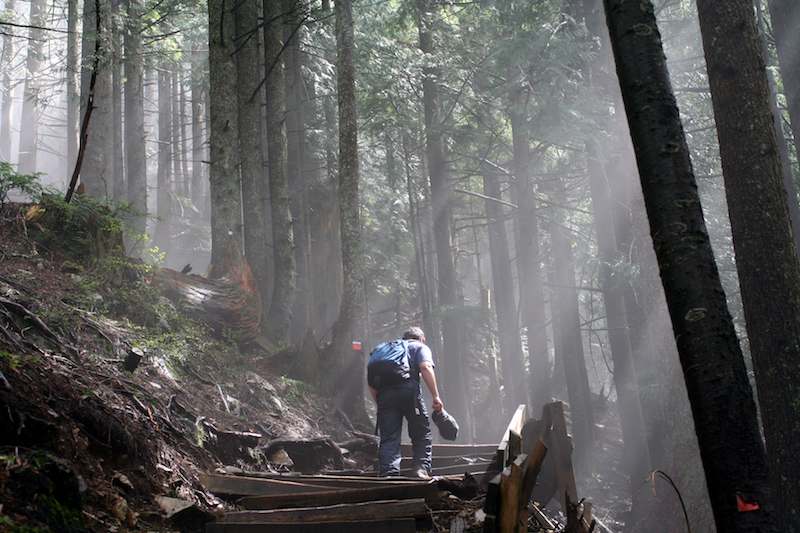 A man walking up the Grouse Grind hike