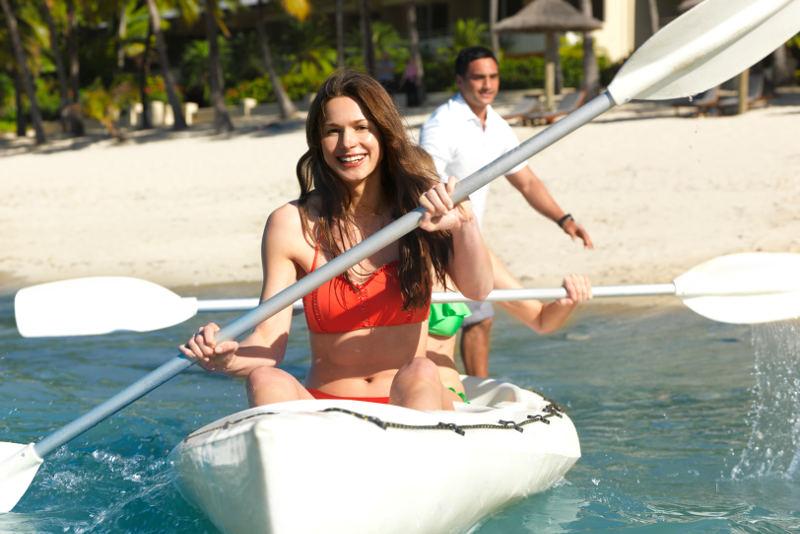 lady kayaking in casteye bay hamilton island