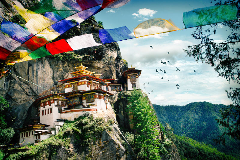 A Buddhist monastery clings to a hillside in Bhutan.