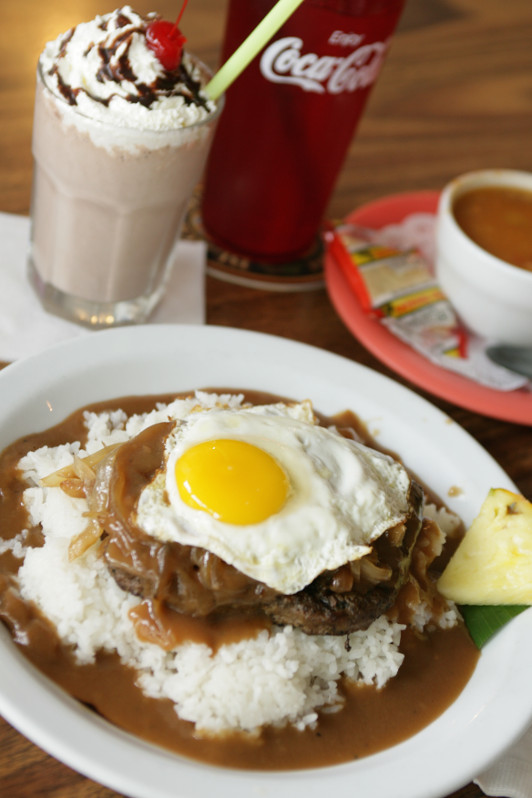 loco moco breakfast stack, eggs, rice, gravy and beef on a plate