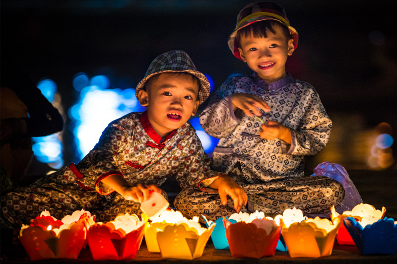Young boys with lanterns in Hoi An, Vietnam.