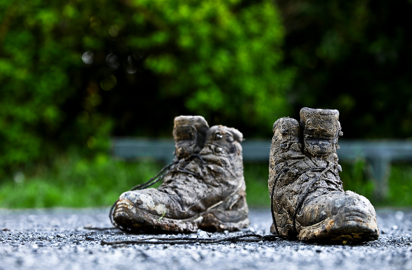 A pair of muddy hiking boots