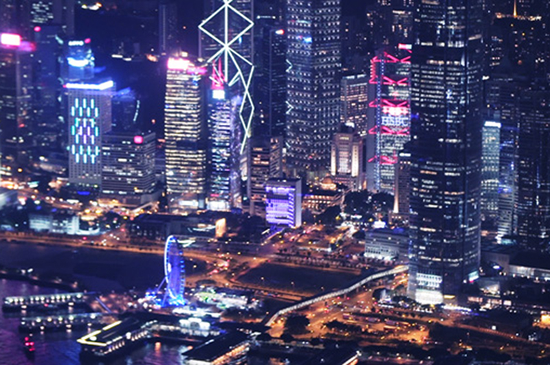 A night-time view of the Hong Kong cityscape.