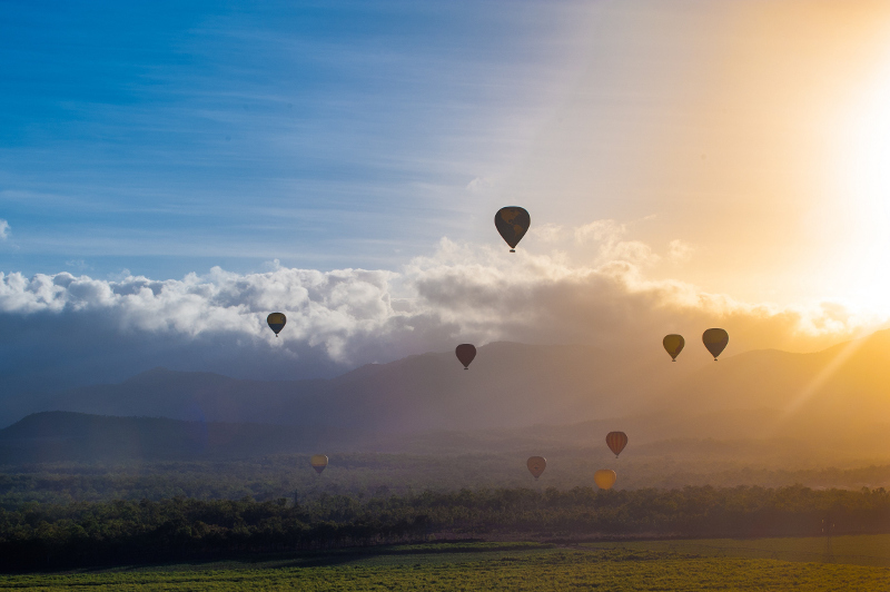 Hot air balloons rise over the Atherton Tablelands