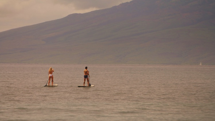 Greer and Jason paddle boarding at the Hyatt Regency Maui Resort & Spa during The 48 Hour Destination: Hawaii.