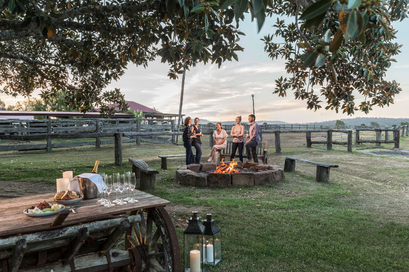 group standing by fire pit at spicers hidden vale