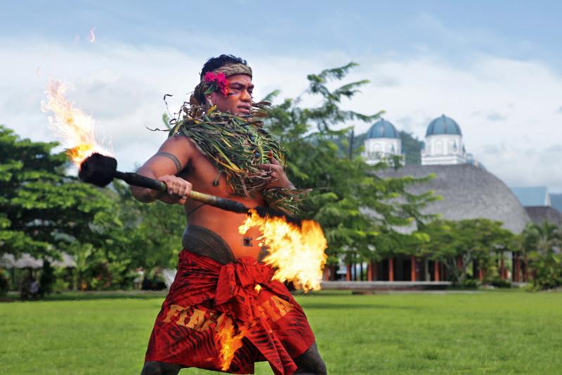 Samoan male dancer fire twirling