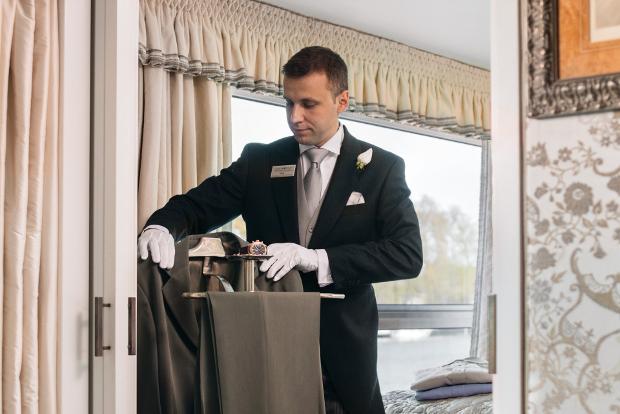 In-suite butler helping guests