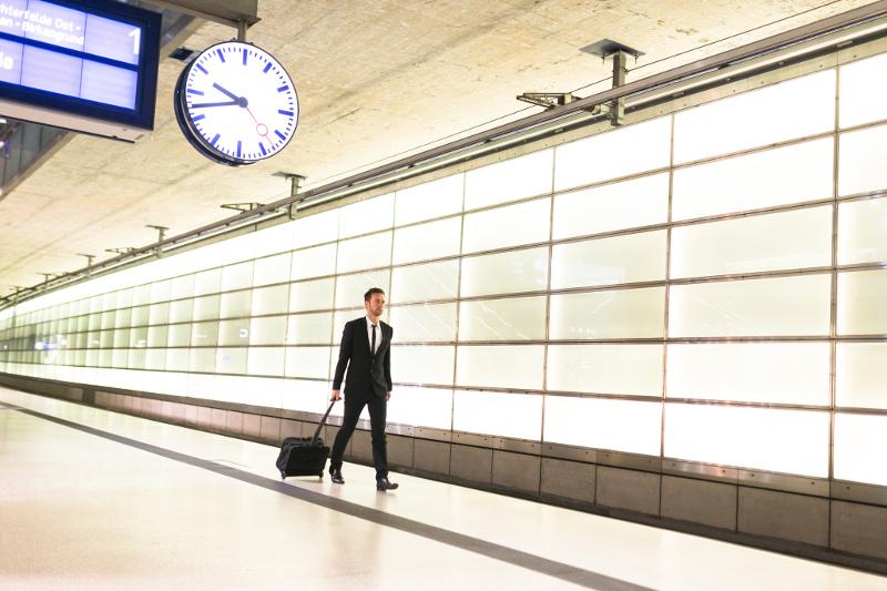 A man walking on a train platform