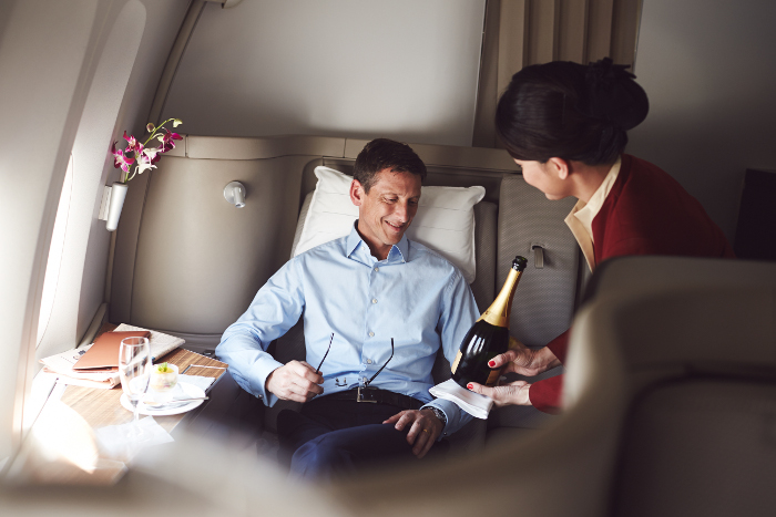 Champagne service in first class onboard cathay pacific