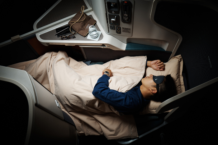 Cathay Pacific Business Class beds transform to full-flat for maximum comfort and rest.