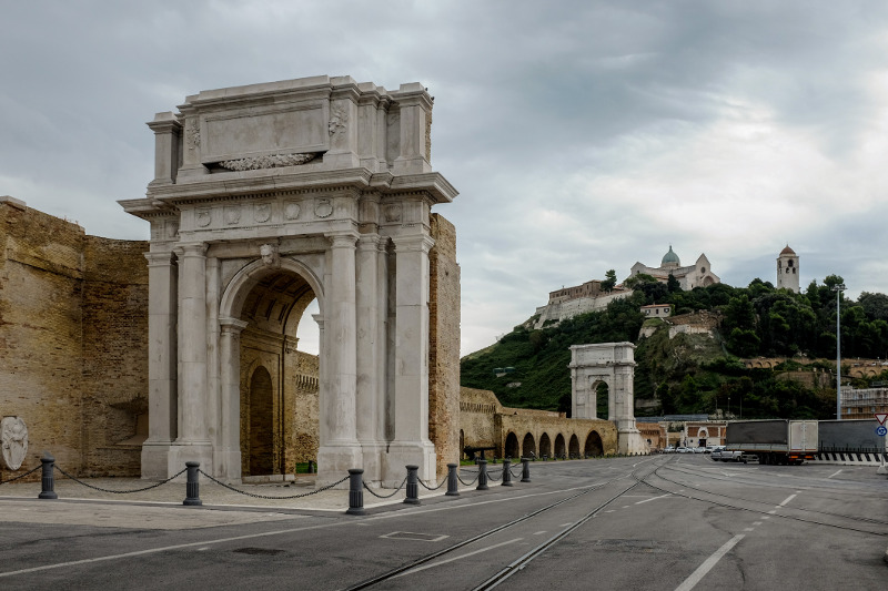 A Roman arch still stands amid the bustle of Ancona's port. Image: Getty