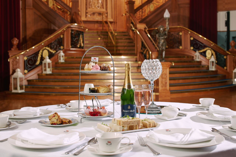 Afternoon tea in front of staircase
