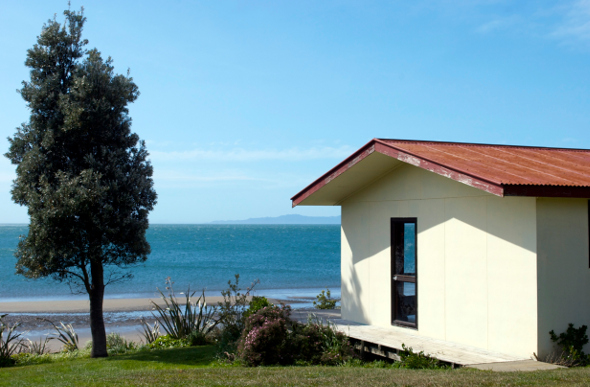 A beachside hut, or bach, in New Zealand.