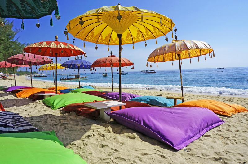 Colourful umbrellas on the beach in Kuta