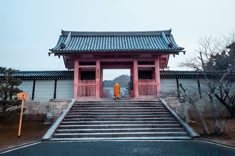 A monk climbs the steps to the inner gate of Ninna-Ji Temple in western Kyoto