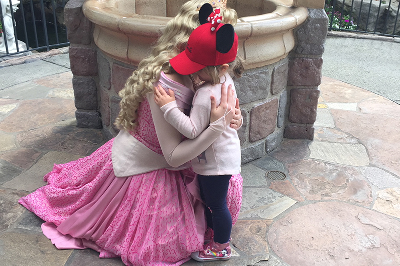 Child hugs princess at Disneyland Resort, Anaheim