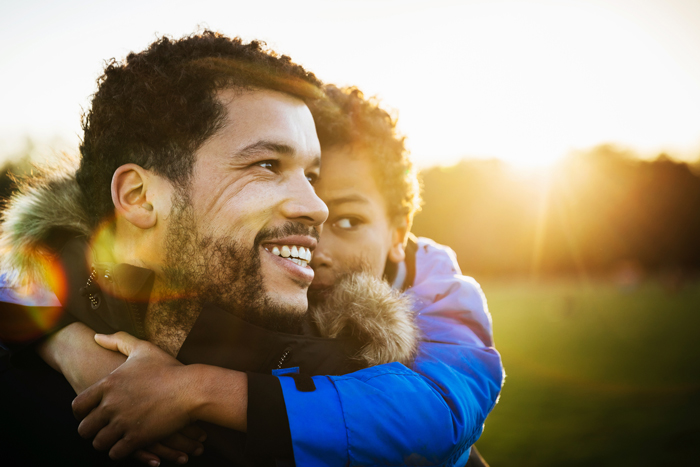 father and son with sun behind them - lessons from travelling with kids