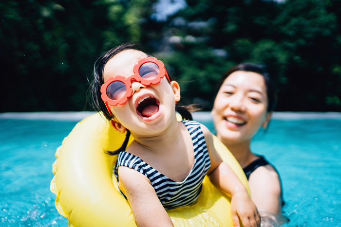mother daughter in pool - life lessons from travelling with children