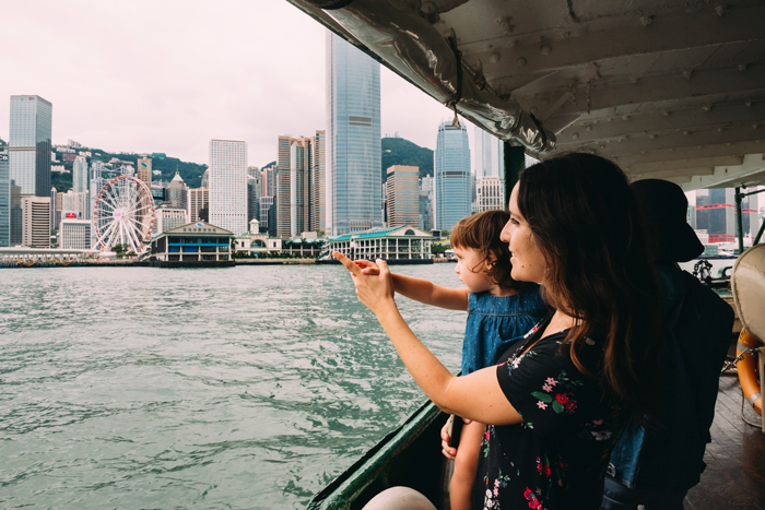 daughter and mum on kowloon ferry - life lessons from travelling with kids