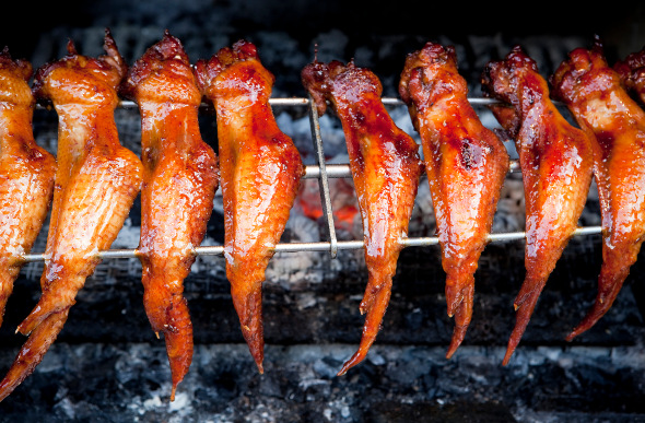 Grilled chicken at a street food stall in Malaysia.