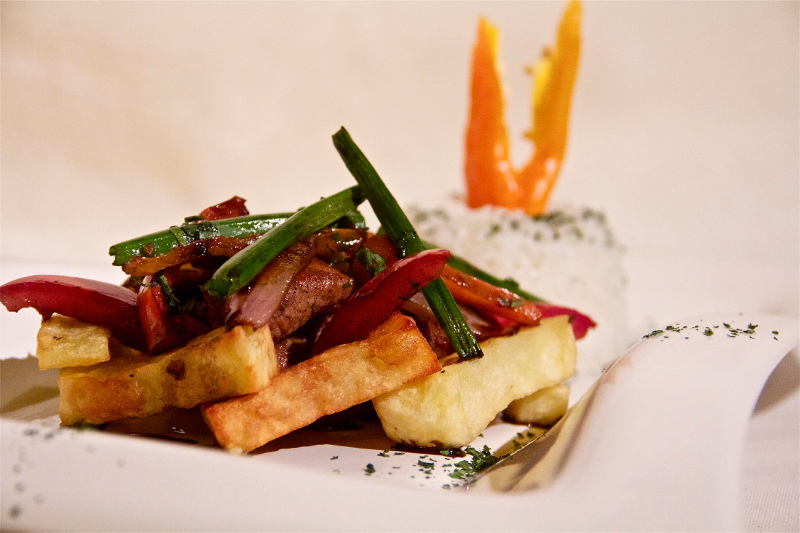 Lomo saltado - beef strips served with hot chips and rice.