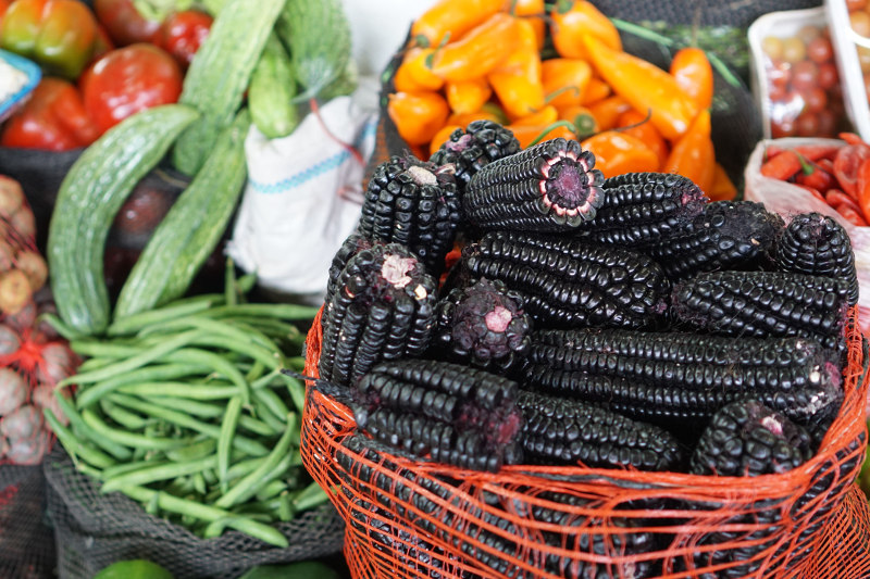 A close-up view of corn, beans and other produce at a market in Lima, Peru.