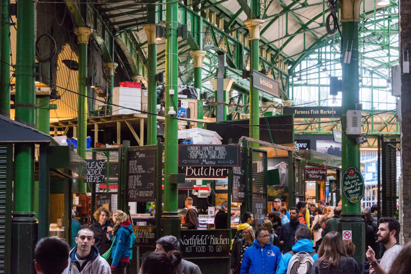 Shoppers walking through London's Borough Market.