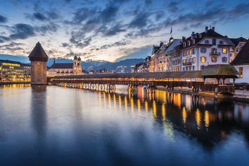 Sunset at Chapel Bridge in Lucerne. Image: Getty