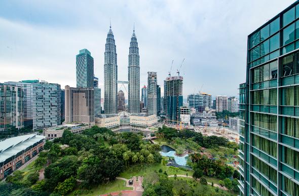 The Petronas Towers dominate the skyline of Kuala Lumpur, Malaysia.